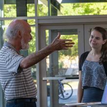 A professor talks to a student